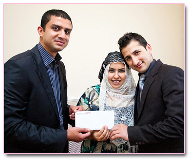 Adeem Younis presents Fawad and Farhan with Umrah Tickets.